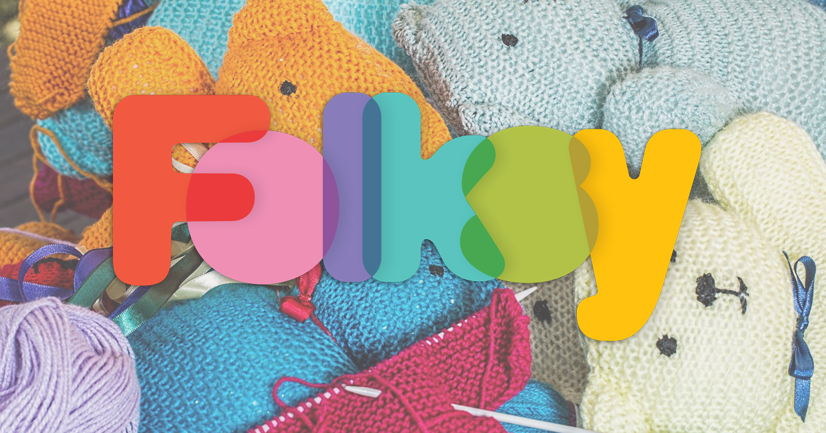 Folksy logo on background of knitted teddy bears
