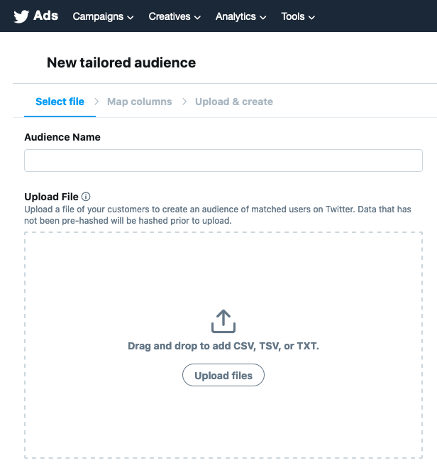 Screenshot of a Twitter page to create a new tailored audience. It shows how you can upload mailing list data via CSV or TXT to create an audience segment on social media.