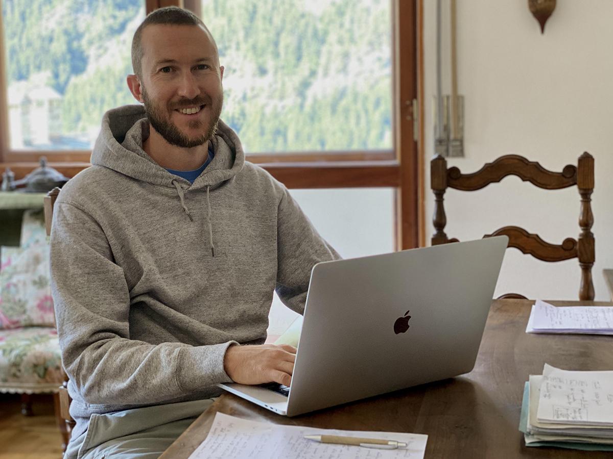 Andrea Bosoni, founder of Zero to Marketing, at his laptop.