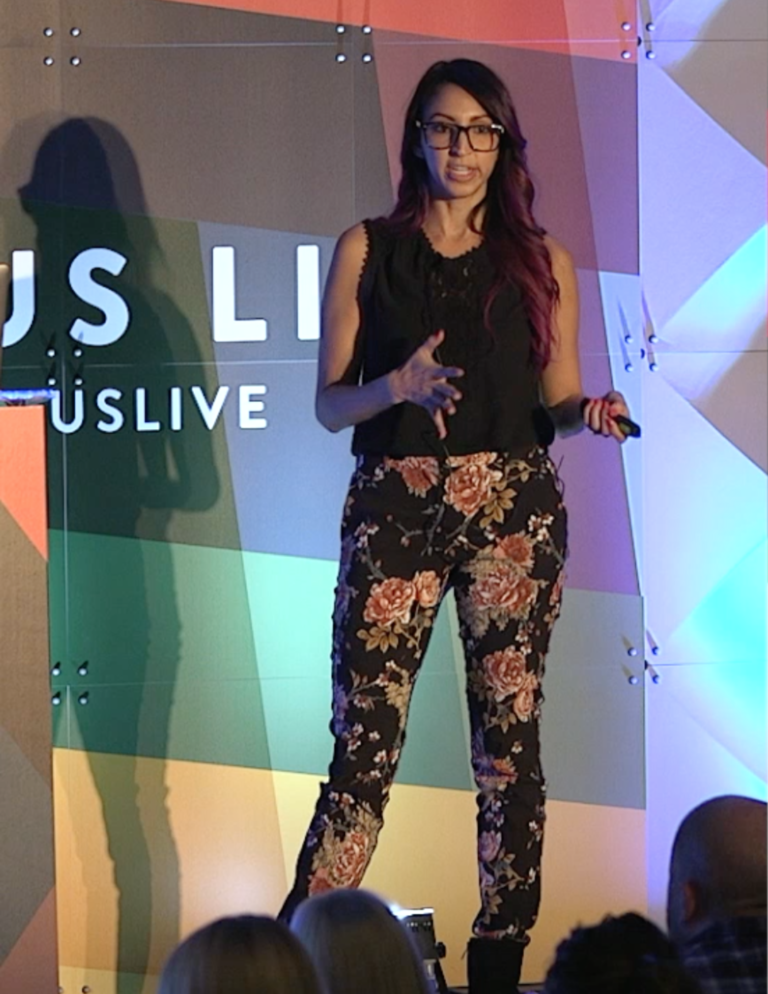 Picture of Crystal Ledesma giving a talk at Litmus Live in 2018